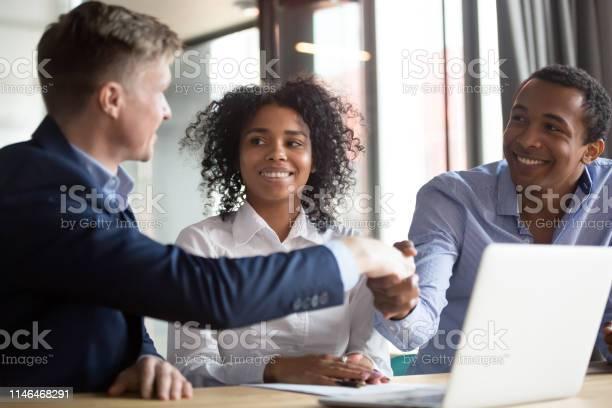 Happy clients african couple handshake insurer broker manager make picture id1146468291?b=1&k=6&m=1146468291&s=612x612&h=ned2uegvgbglulyxfjmzifcfqlyilmoulwpsknu8hja=