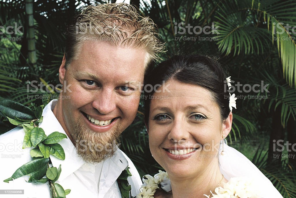Happy closeup of a bride and groom on Hawaii royalty-free stock photo