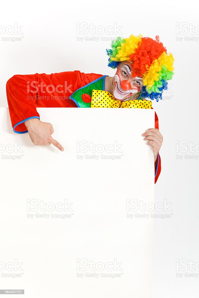 Happy clown looking at blank banner with copy space royalty-free stock photo