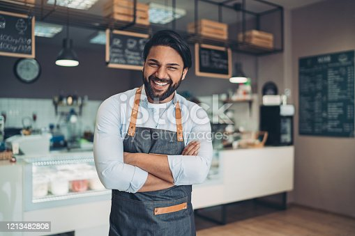 Portrait of a smiling young man in a cafeteria