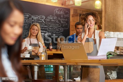 istock Happy Coffee shop paying bills 597275830
