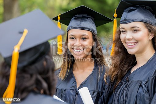 istock Happy college friends smile after receiving diplomas 613884700