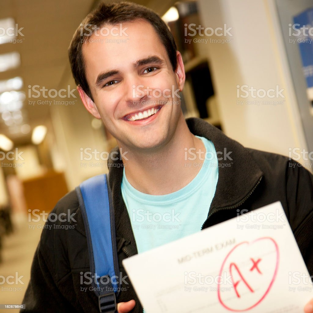 Happy College Student Holding A+ Exam Paper royalty-free stock photo
