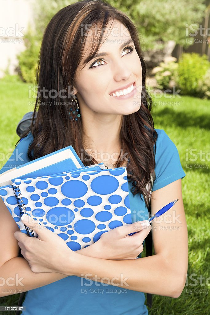 Happy college student holding book royalty-free stock photo