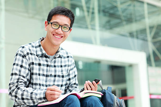 happy college student in campus stock photo