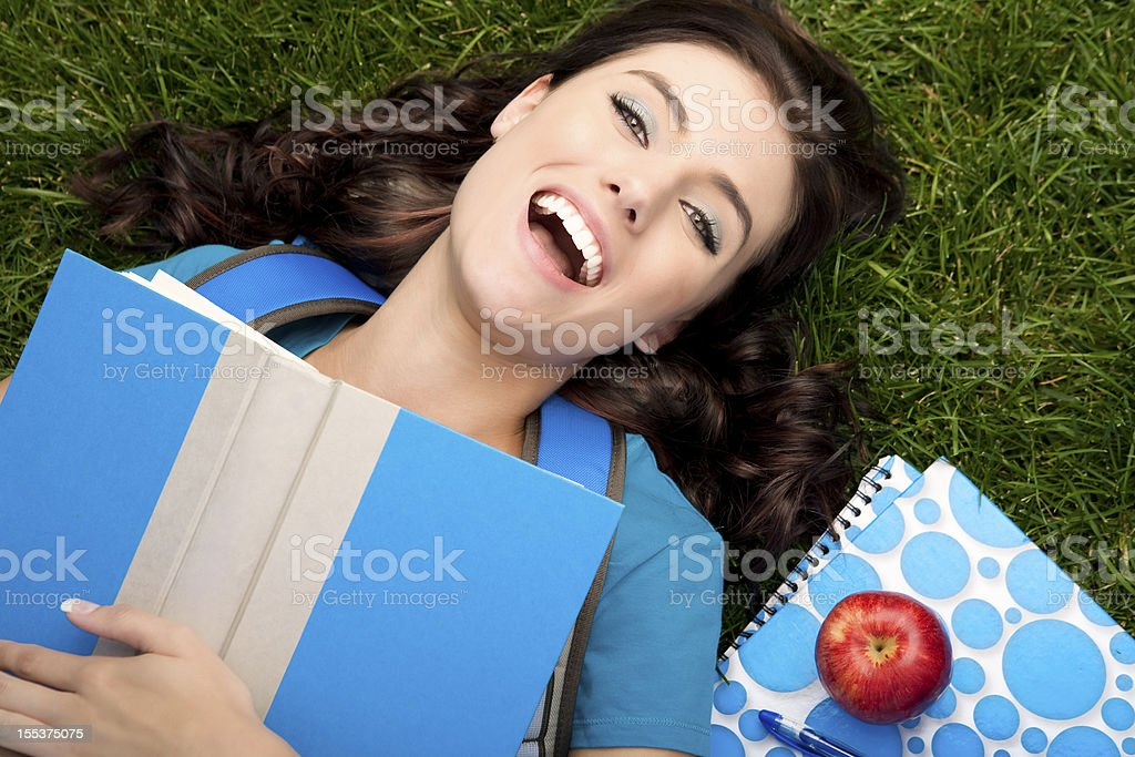 Happy college student relaxing royalty-free stock photo