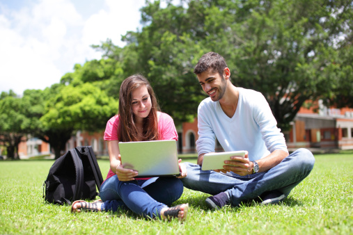 Happy College students using computer