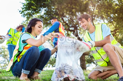 istock Happy community service people cleaning up the park 578274632