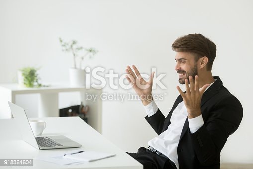 istock Happy company ceo satisfied with online achievement looking at laptop 918364604