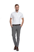 istock happy confident casual man standing with hands in pockets 1131989522
