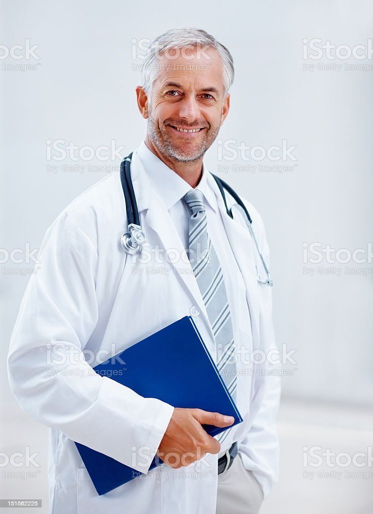 Happy confident mature doctor holding a file royalty-free stock photo