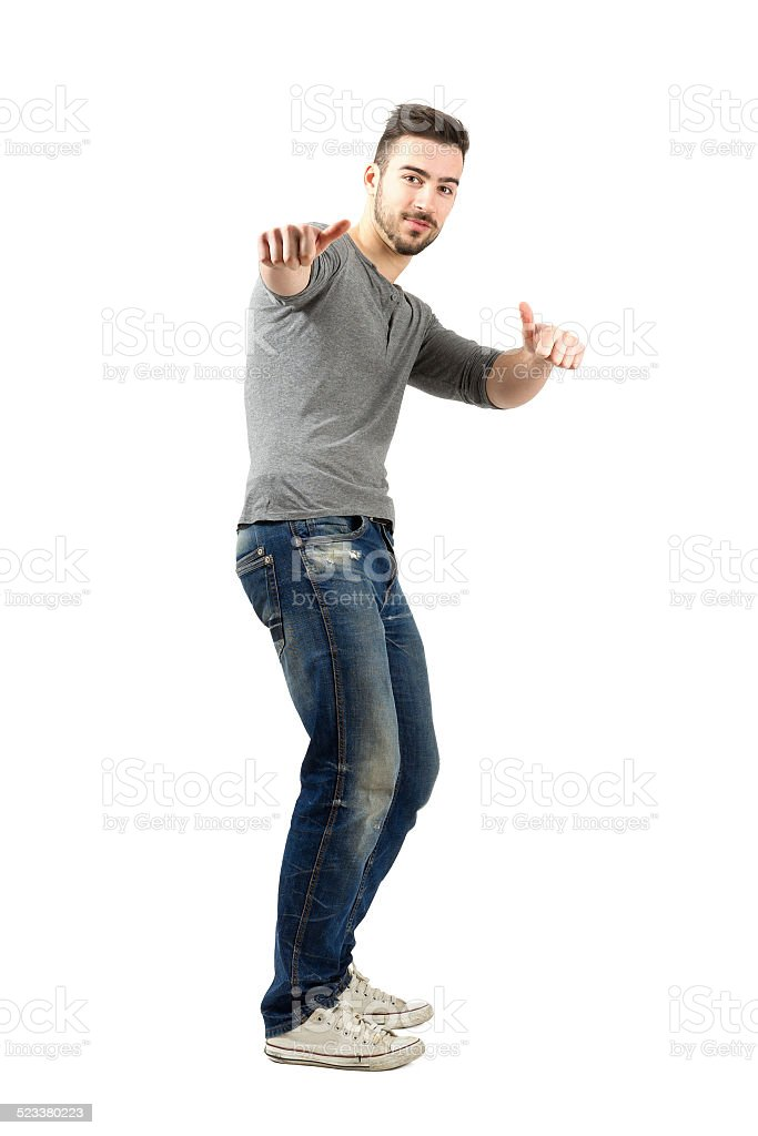 Happy confident young man with thumbs up gesture stock photo