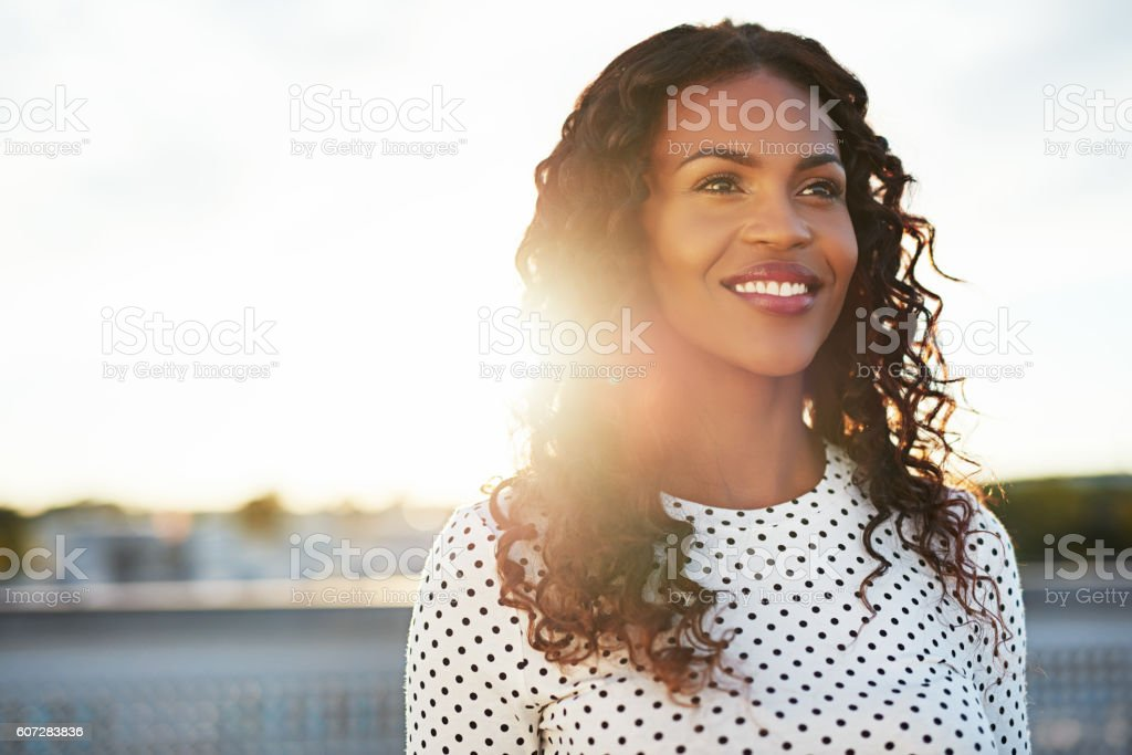 Happy confident young woman stock photo