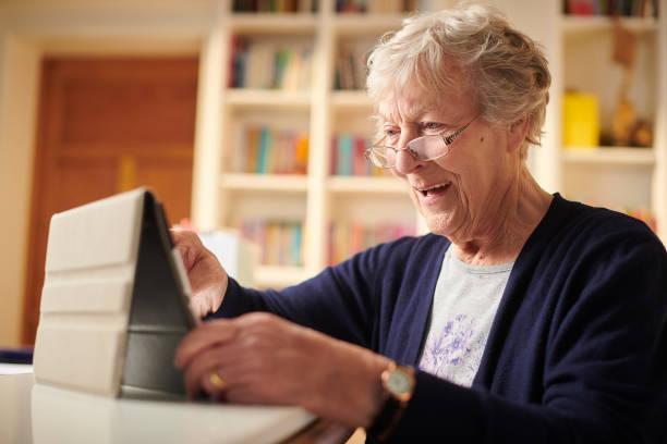 happy connected senior woman stock photo