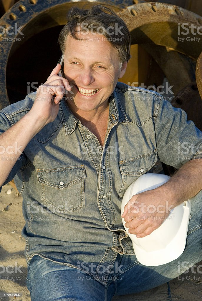 Happy construction worker on cellphone. royalty-free stock photo