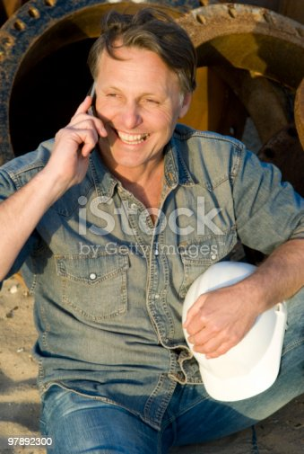 Happy Construction Worker On Cellphone Stock Photo & More Pictures of 40-44 Years