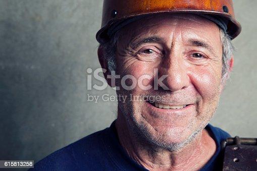 istock Happy Construction Worker 615813258