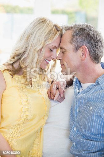 istock Happy couple about to kiss 803040090