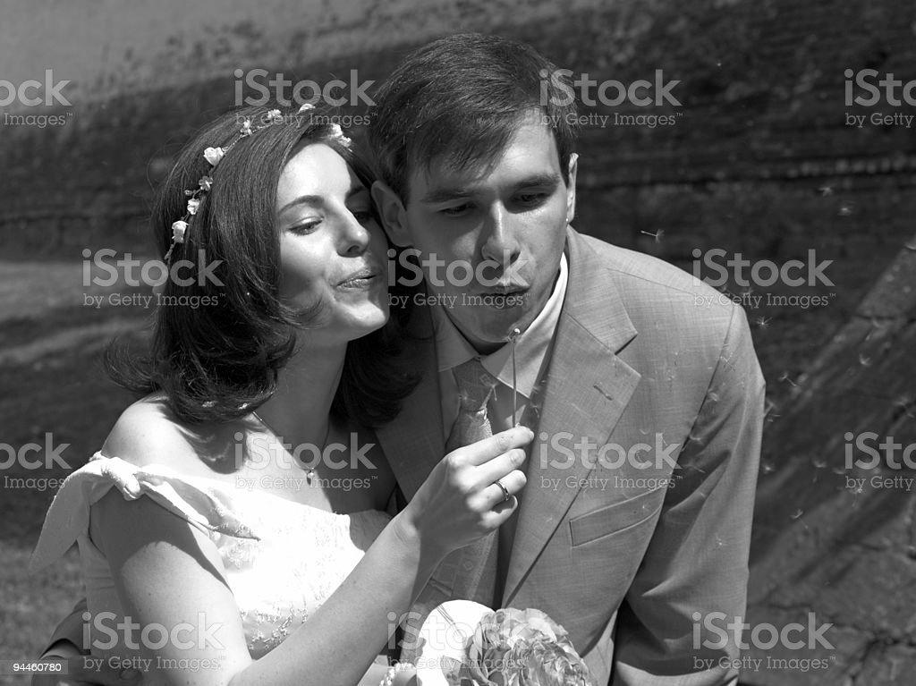 Happy couple and dandelion stock photo