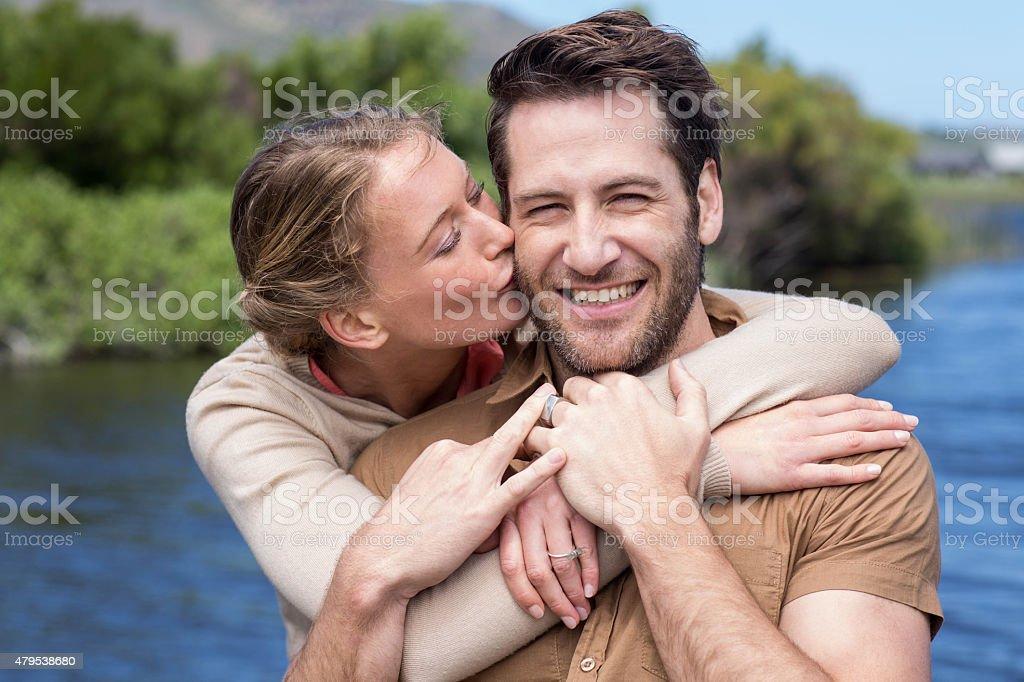 Happy couple at a lake stock photo