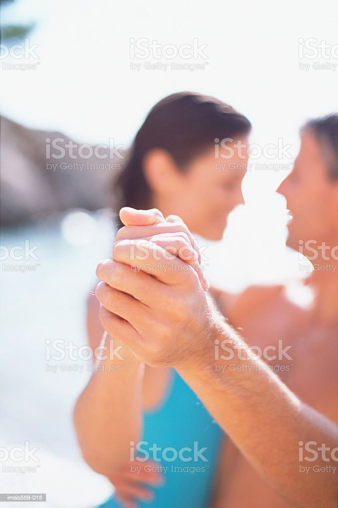 Happy couple at beach royalty free stockfoto