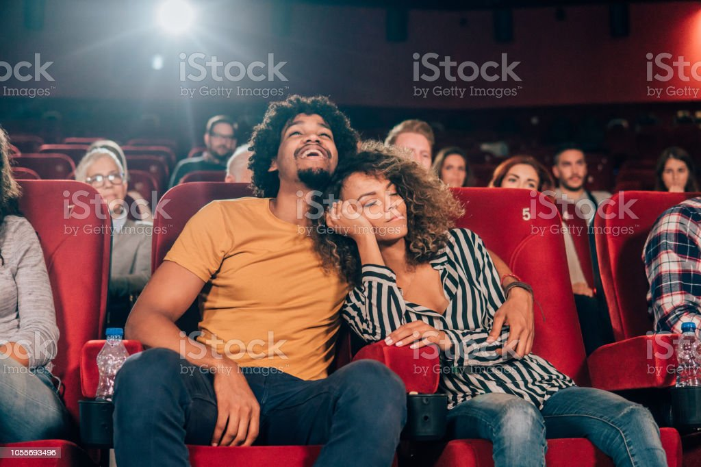 Happy couple at cinema stock photo