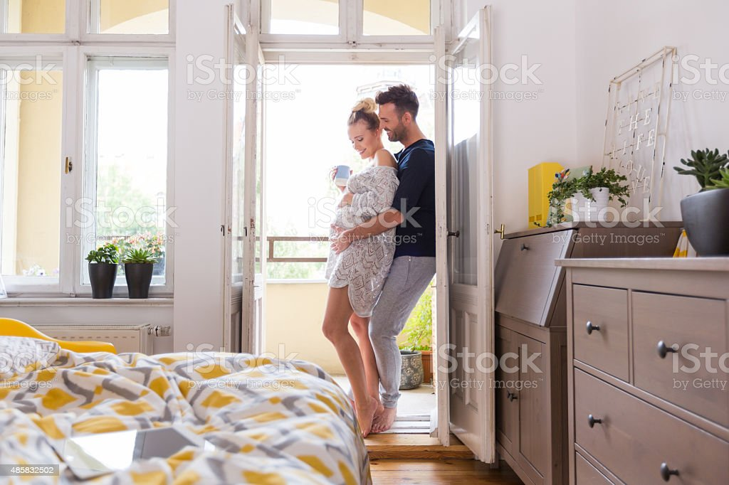 Happy couple at home in the morning stock photo