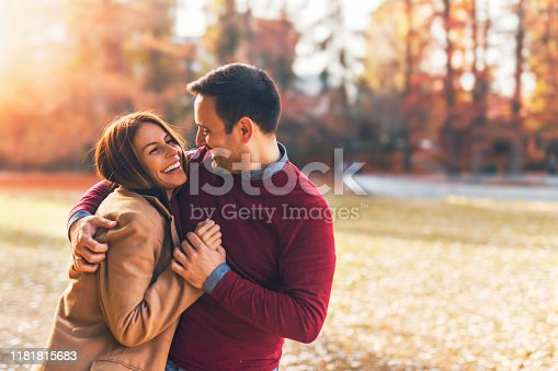 istock Happy couple at public park in autumn 1181815683