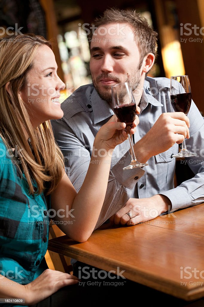 Happy Couple at Restaurant Drinking Champaign royalty-free stock photo