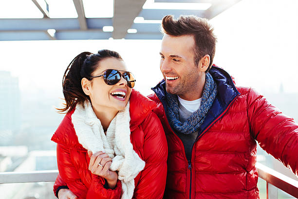 happy couple at roof top - jacket stock photos and pictures