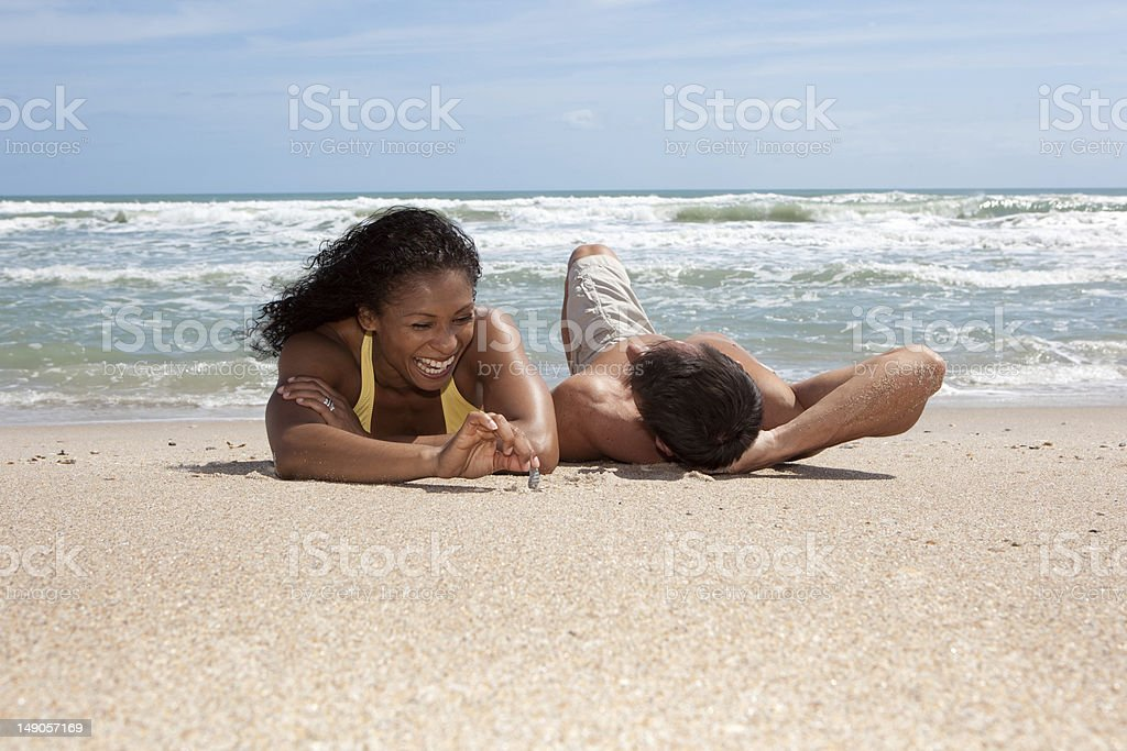 Happy couple at the beach royalty-free stock photo