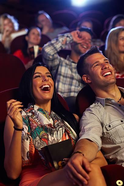 Happy couple at the cinema stock photo