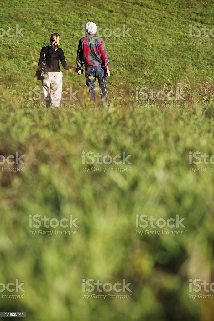 Happy couple at walk royalty-free stock photo
