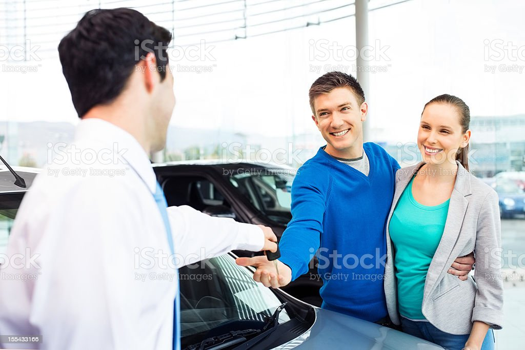 Happy Couple Buying Car royalty-free stock photo