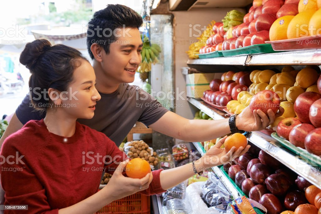 Happy couple buying groceries stock photo