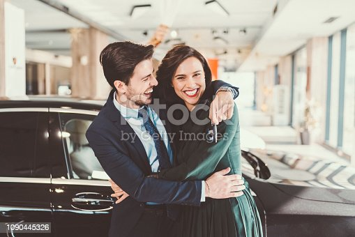 Young man buying new car for his wife on Valentine's day