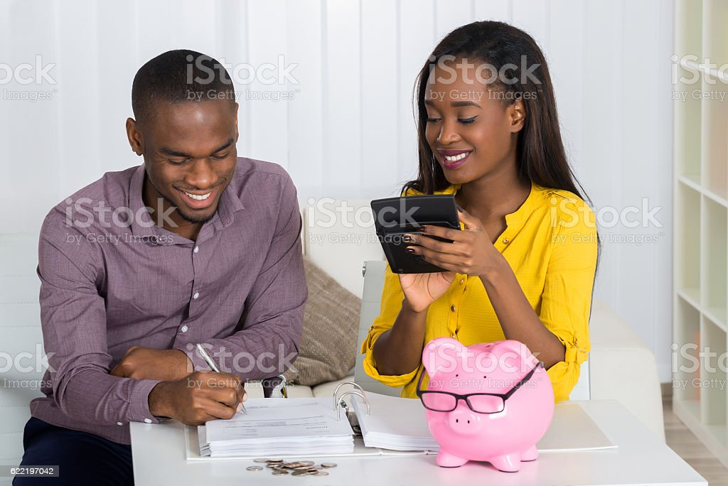 Happy Couple Calculating Bill stock photo