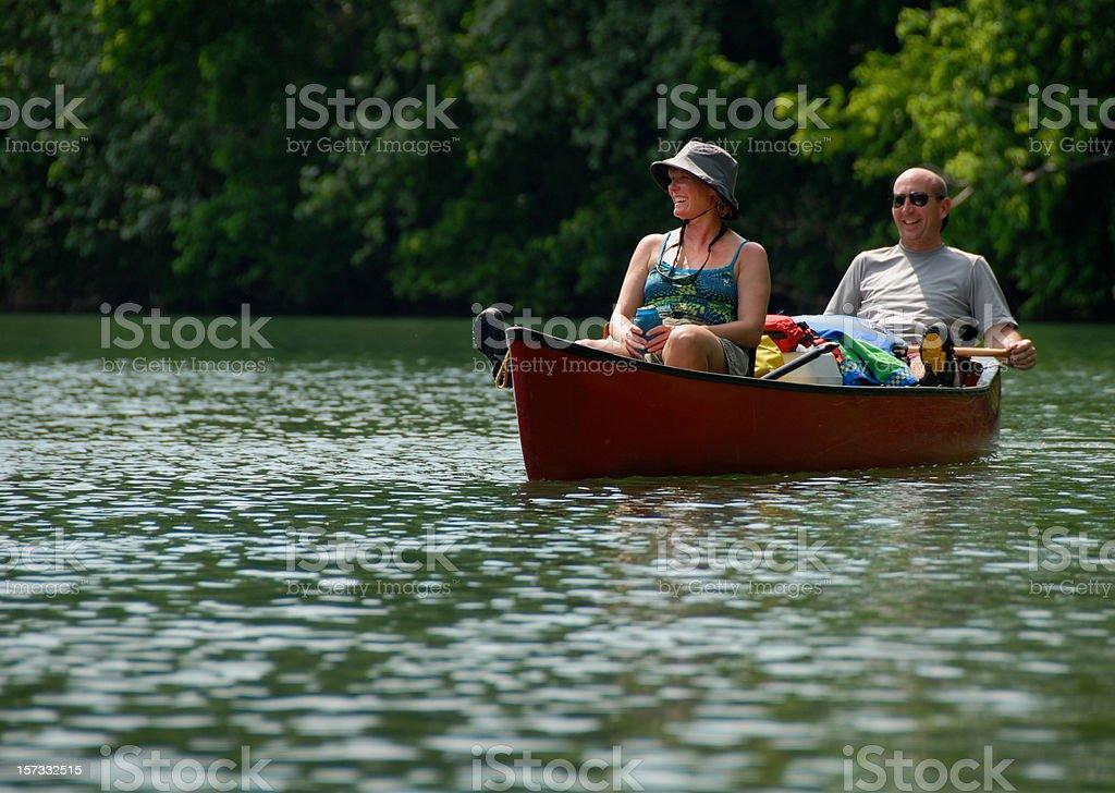 Happy Couple Canoeing royalty-free stock photo