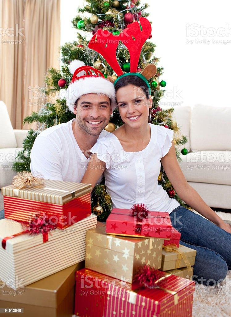 Happy couple celebrating Christmas at home royalty-free stock photo