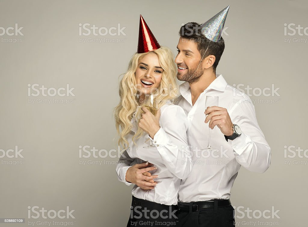 Happy couple celebrating new year with glasses of the champagne stock photo