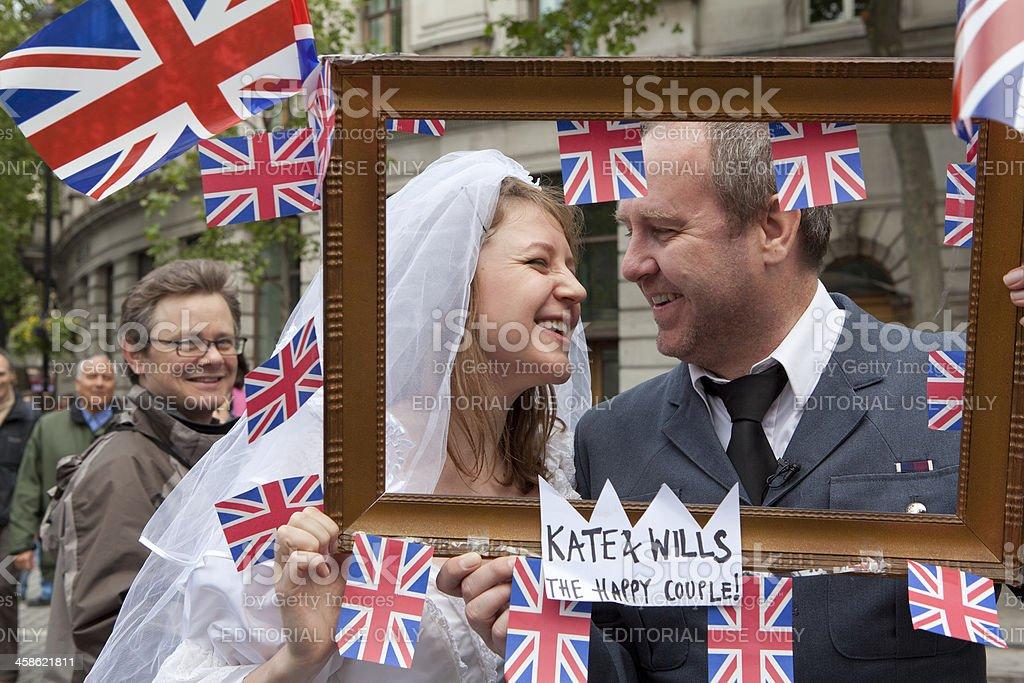 Happy Couple Celebrating the Royal Wedding stock photo