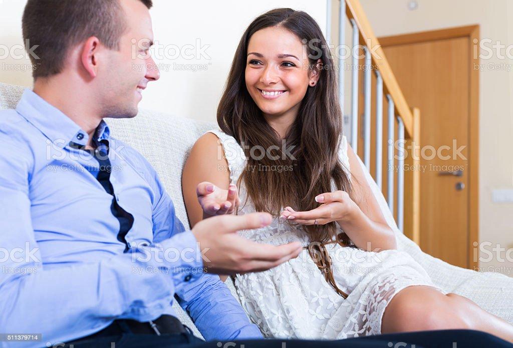 Happy couple chatting stock photo