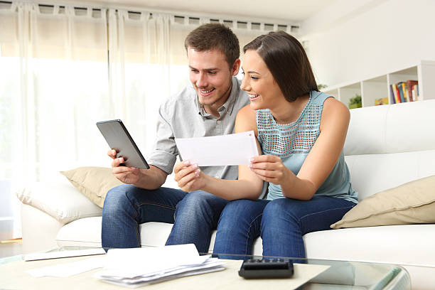 Happy couple checking bank account online – Foto