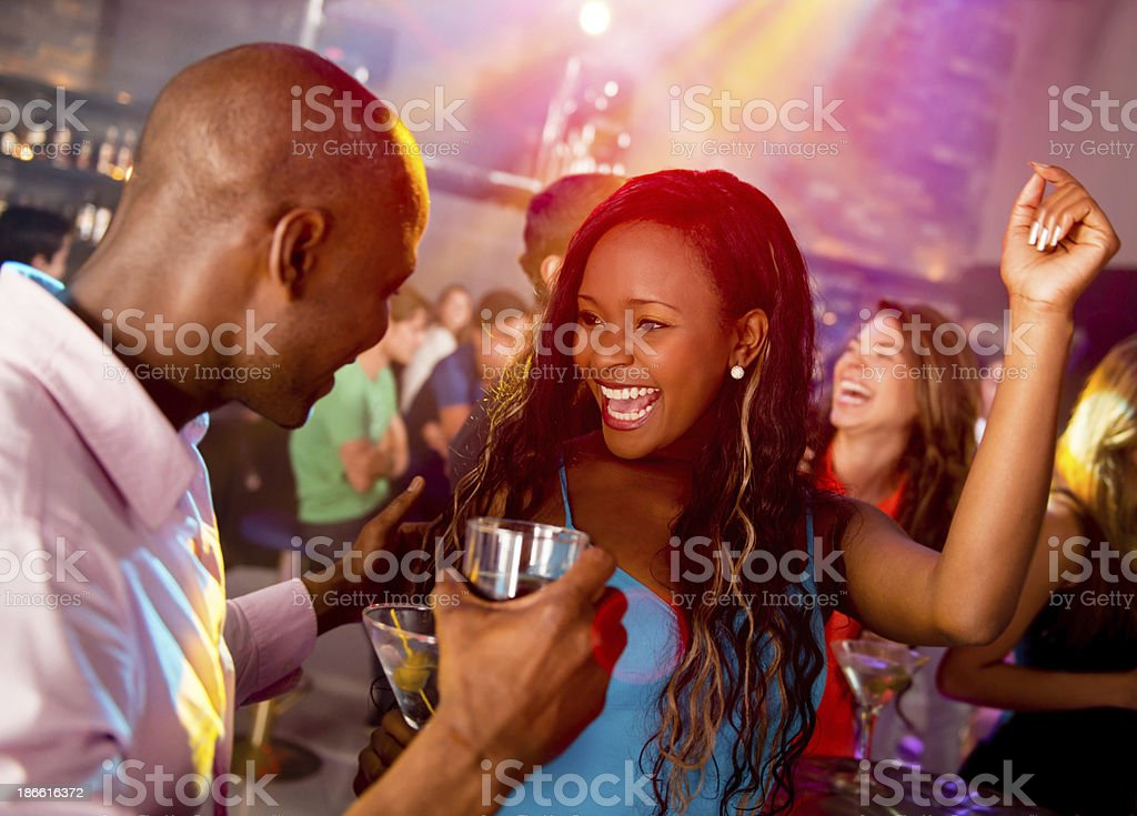 Happy couple clubbing stock photo
