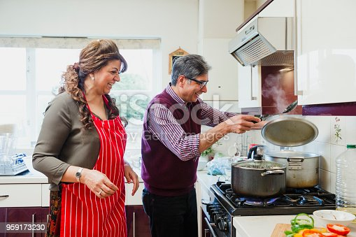 istock Happy Couple Cooking at Home 959173230