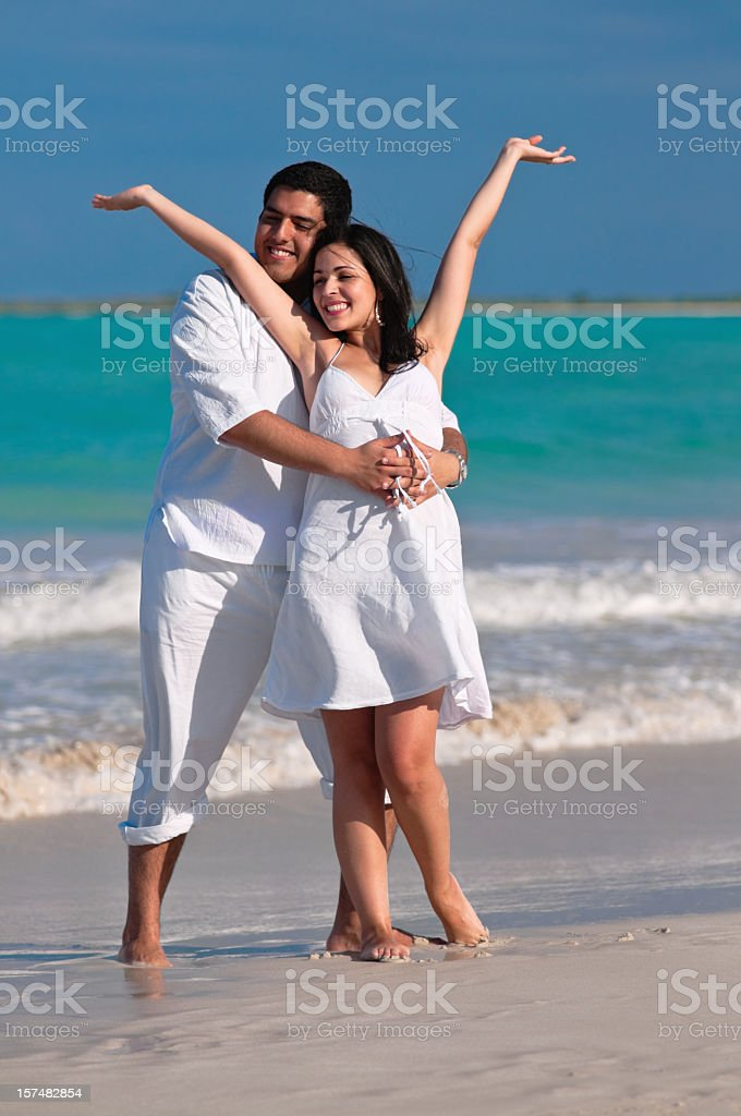 Happy couple dancing on a beach royalty-free stock photo