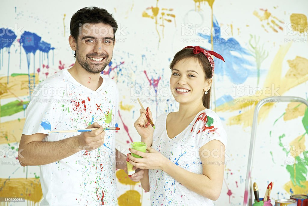 Happy couple decorating royalty-free stock photo