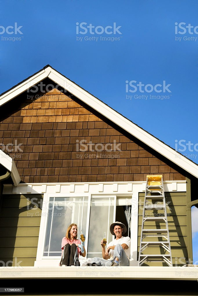 Happy couple doing a home improvement project married wife husband royalty-free stock photo