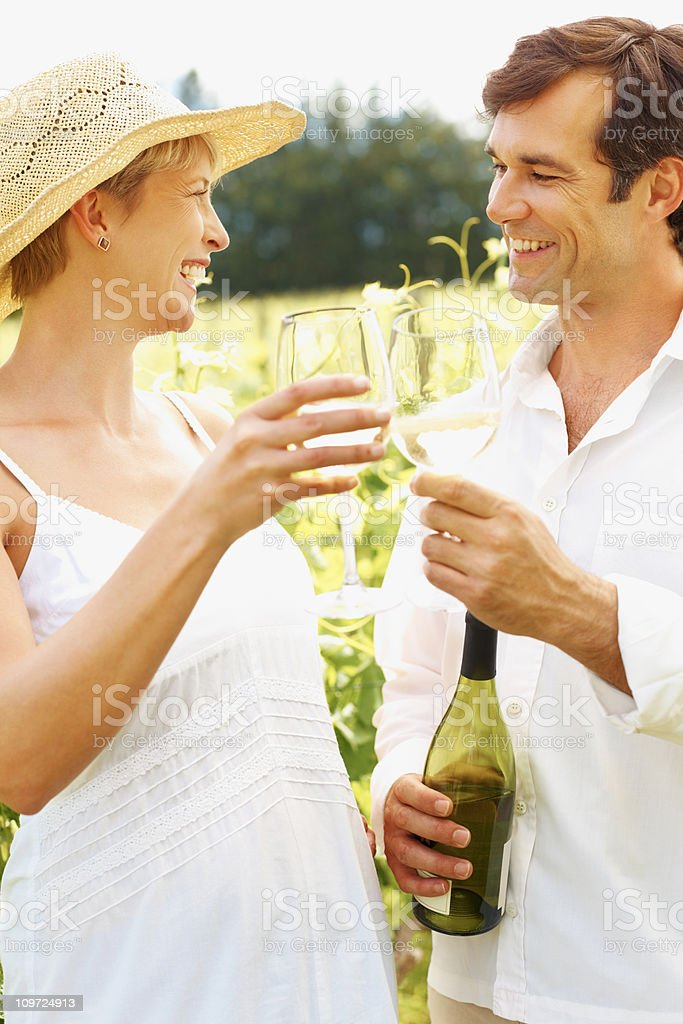 Happy couple drinking wine together at a countryside royalty-free stock photo