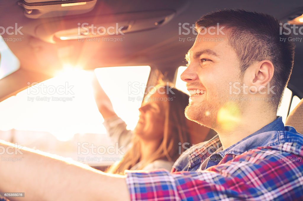 Happy Couple driving in car stock photo